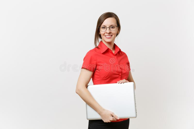 Portrait of beautiful young business teacher woman user in red shirt, glasses holding laptop pc computer underarm. On white background. Education or teaching in stock photo
