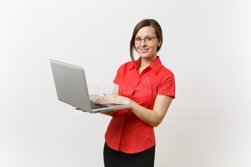 Portrait of beautiful young business teacher woman user in red shirt, glasses working typing on laptop pc computer. Portrait of beautiful young business teacher royalty free stock image