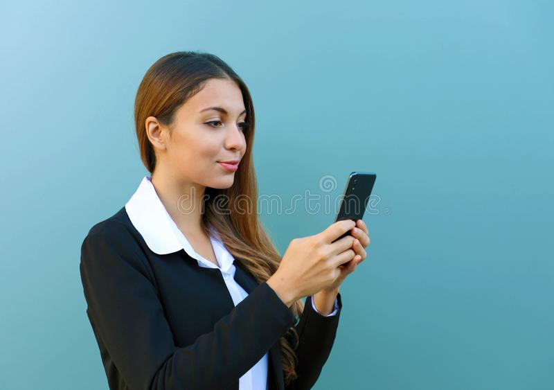 Portrait of beautiful young business woman chatting with smart phone outdoors stock photography