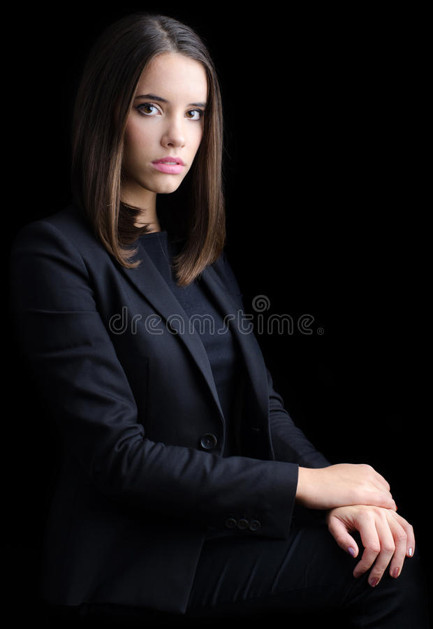 Portrait of beautiful young business woman isolated on black royalty free stock images