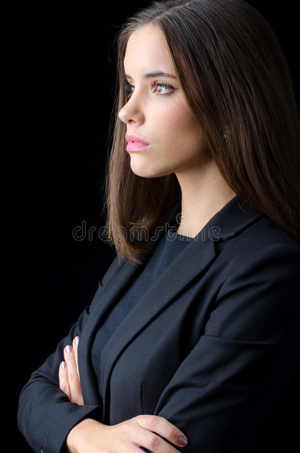 Portrait of beautiful young business woman isolated on black stock photo