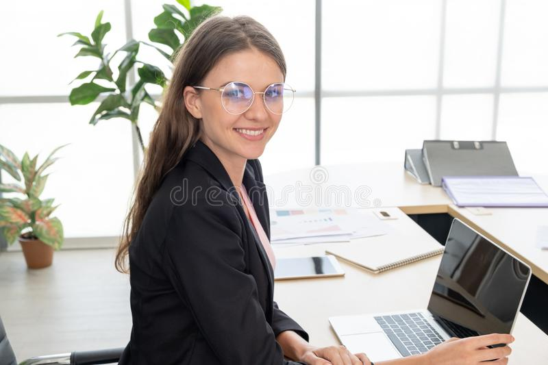 Portrait of beautiful young businesswoman smiling and looking straight at the camera stock photography