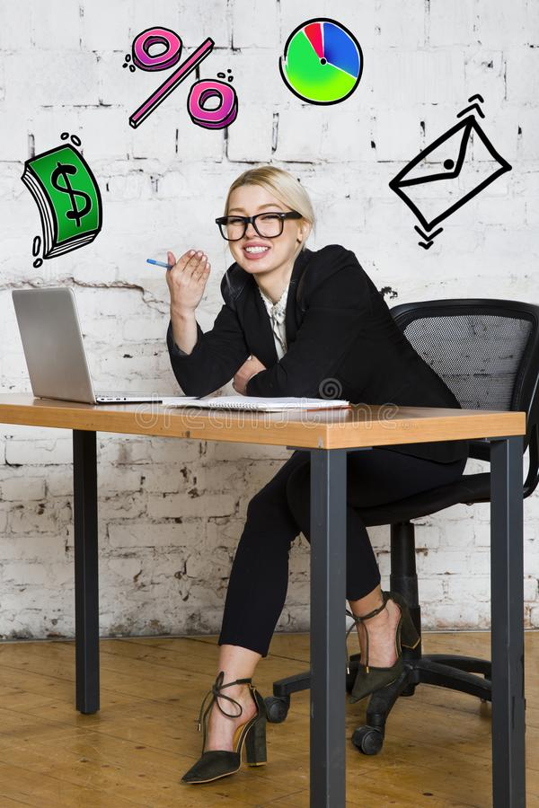 Portrait of a beautiful young businesswoman wearing a white shirt and black suit and thinking. Business concept. stock image