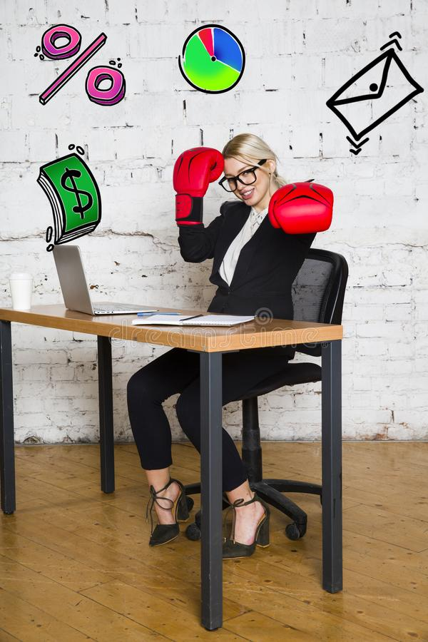 Portrait of a beautiful young businesswoman wearing a white shirt and black suit and thinking. Business concept. stock images