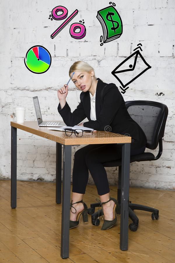 Portrait of a beautiful young businesswoman wearing a white shirt and black suit and thinking. Business concept. royalty free stock photos