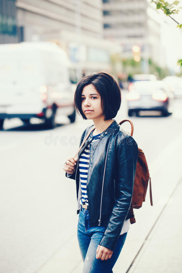 Portrait of beautiful young Caucasian latino girl woman with dark brown eyes and short dark hair in blue jeans royalty free stock photography