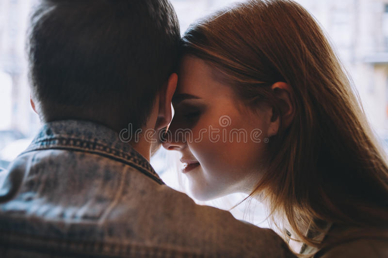 Portrait of beautiful young couple in love at a coffee shop. stock photo