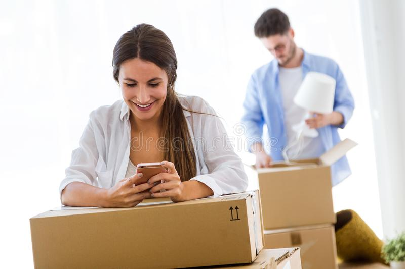Beautiful young couple moving at new home. Portrait of beautiful young couple moving at new home royalty free stock photo