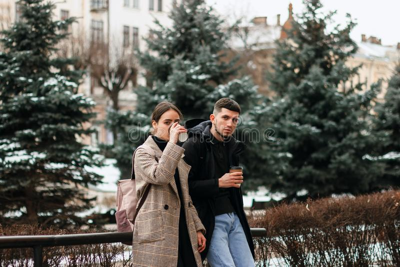 Portrait of beautiful young couple outside in the city center royalty free stock photo