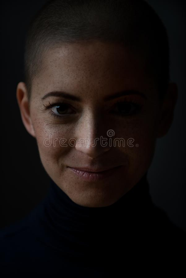 Portrait of a beautiful young courageous smiling female cancer patient, with shaved head. Woman, a cancer patient, portrait. royalty free stock photography