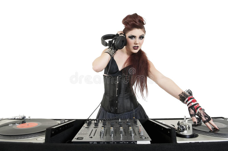 Portrait of beautiful young DJ listening to music over white background stock photography
