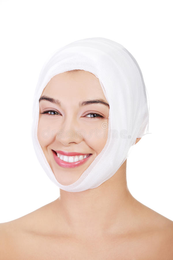 Portrait of beautiful young female face with bandage royalty free stock photography