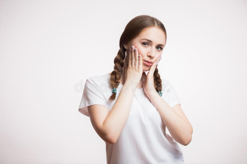 Portrait of beautiful young ginger girl with braid and wearing a white t-shirt looking at camera stock images