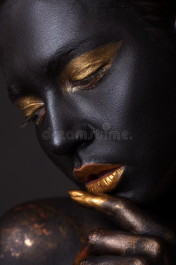 Portrait of a beautiful young girl and creative make-up. stock image