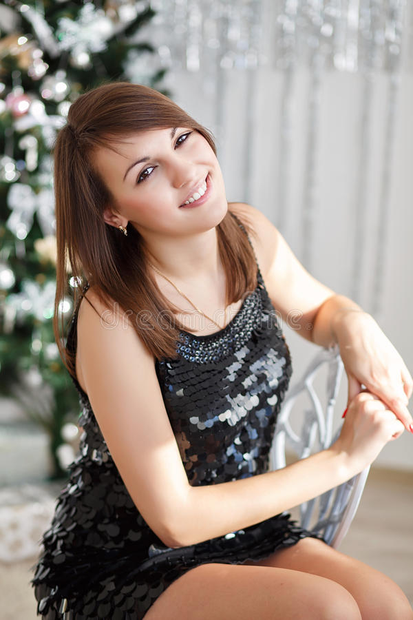 Portrait of a beautiful young girl in elegant Christmas decorati. Portrait of a beautiful smiling girl in elegant Christmas decorations stock photography