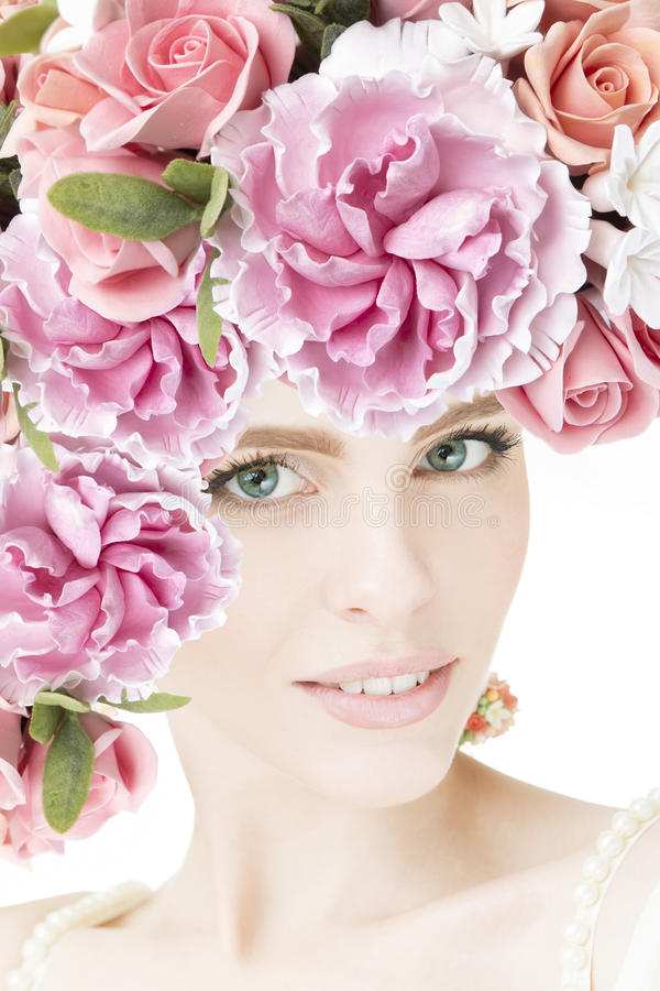 Portrait of beautiful young girl with flowers royalty free stock photo