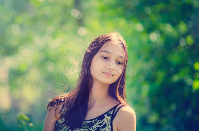 Portrait of a beautiful young girl with long hair. Toning in the style of instagram royalty free stock photo