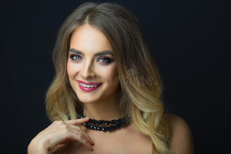 Portrait of beautiful young girl with makeup royalty free stock photography