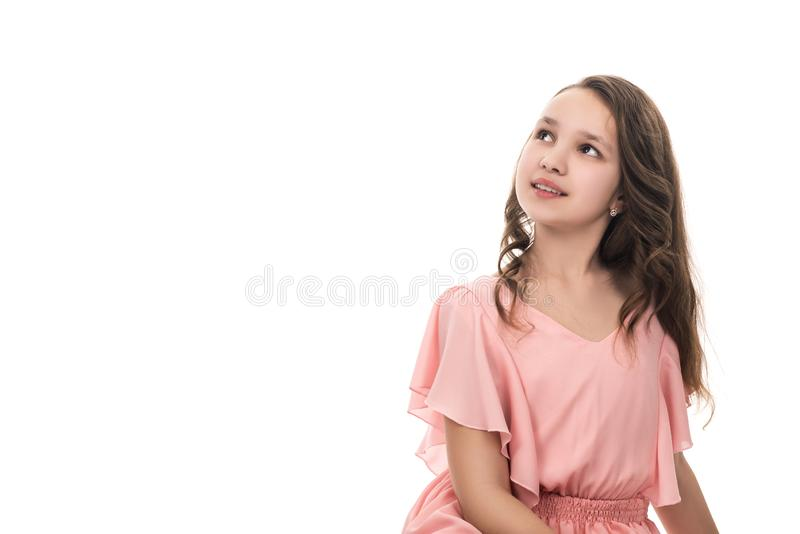Portrait of a beautiful young girl in pink dress, isolated on white royalty free stock photos