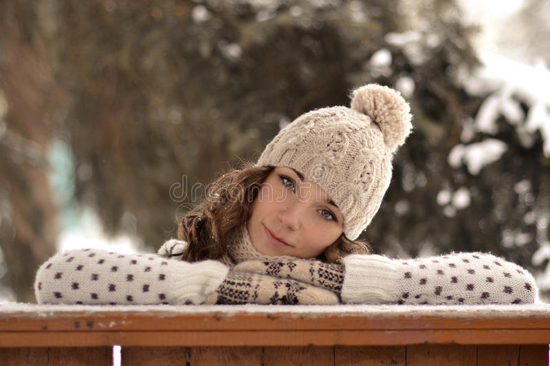 Portrait of beautiful, cute girl in winter hat, winter forest stock images