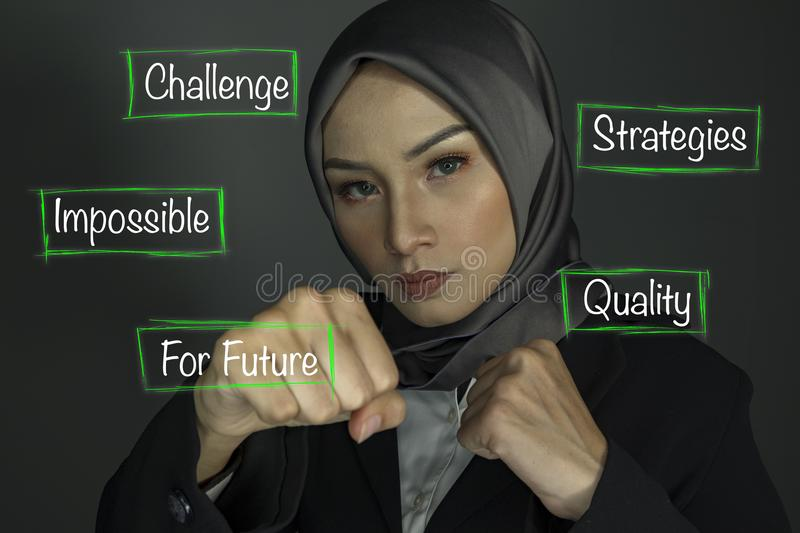 Portrait of beautiful young grinning professional woman with aggressive and confident expression stock image