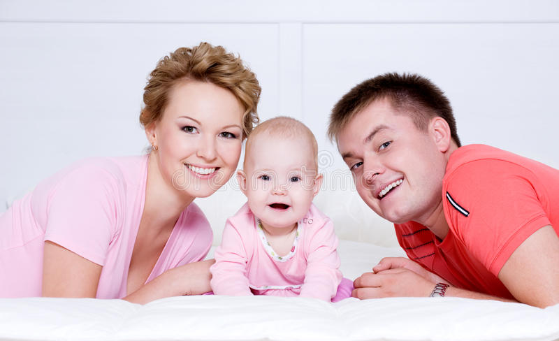 Portrait of the Beautiful young happy family stock photos