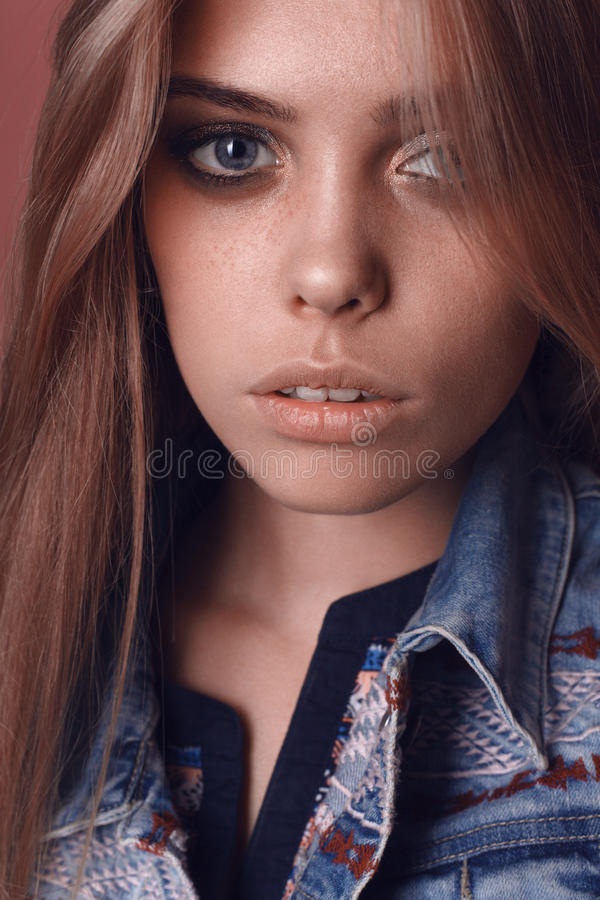 Portrait of beautiful young hippie woman in studio royalty free stock image