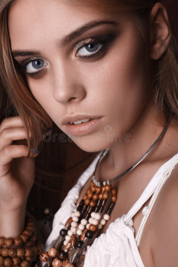 Portrait of beautiful young hippie woman in studio royalty free stock photo