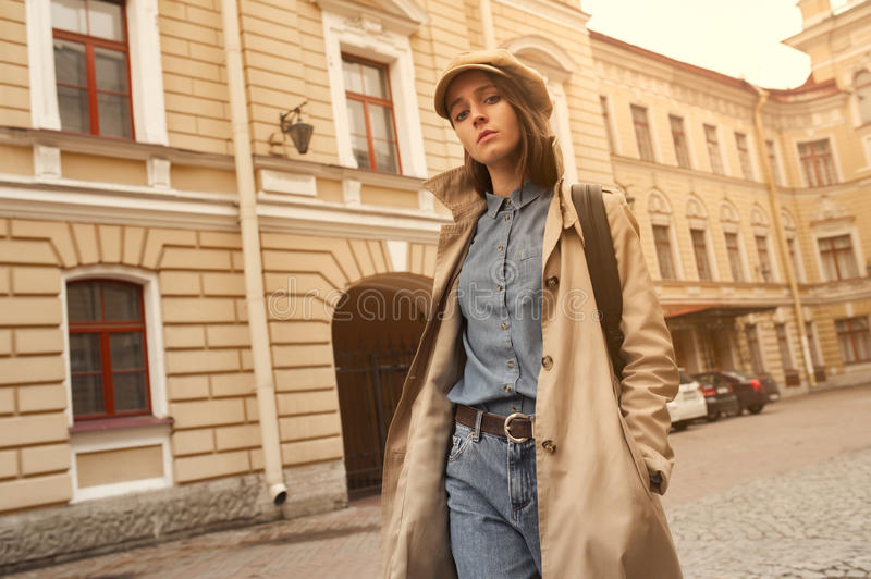 Portrait of a beautiful young hipster girl walks through the streets the old town fun and smiling royalty free stock photography
