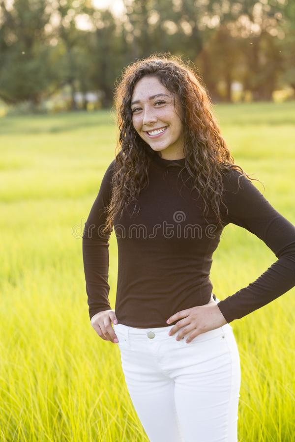 Portrait of a beautiful young hispanic teen girl outdoors royalty free stock images