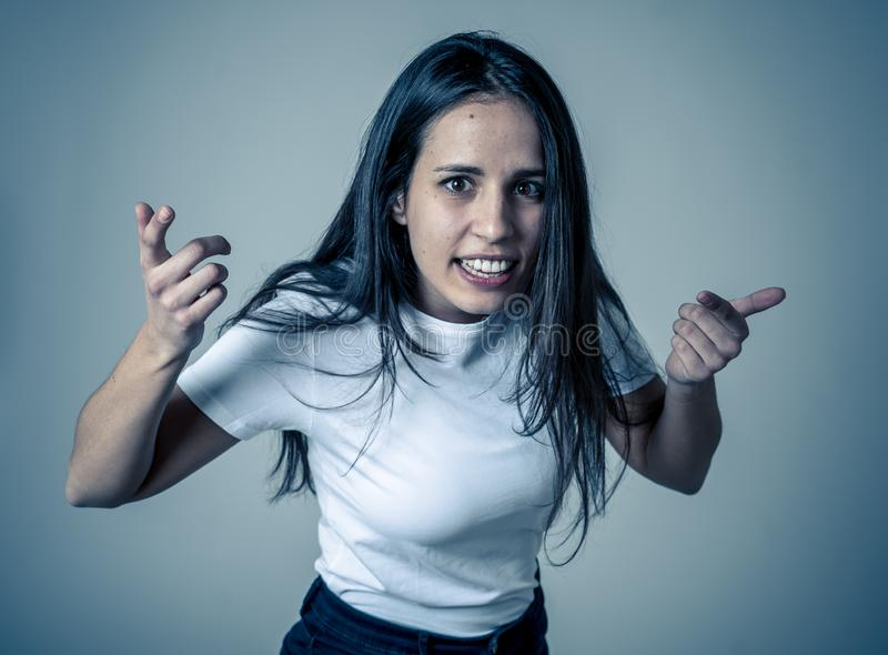 Portrait of beautiful young latin woman with angry and furious face. Human expressions and emotions. Close up of young attractive frustrated latin woman in stock photo