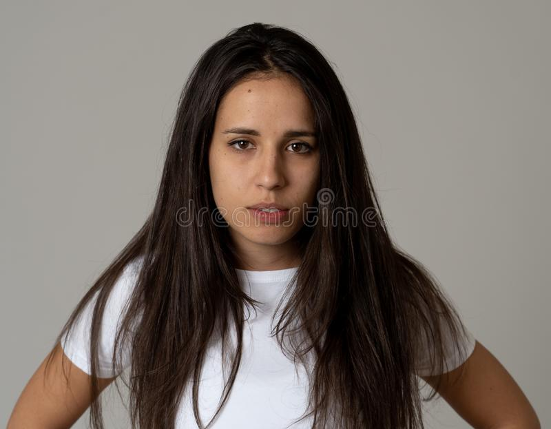 Portrait of beautiful young latin woman with angry and furious face. Human expressions and emotions. Close up of young attractive frustrated latin woman in royalty free stock photos