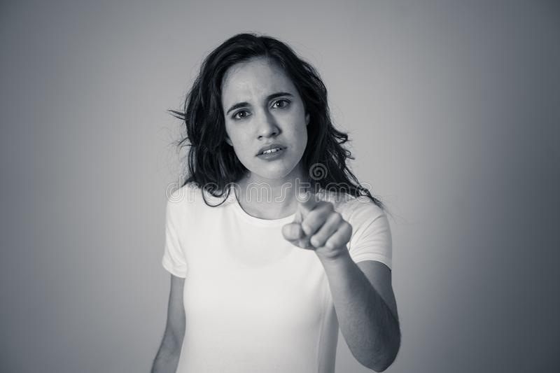 Portrait of beautiful young latin woman with angry and furious face. Human expressions and emotions. Close up of young attractive frustrated latin woman in stock photography