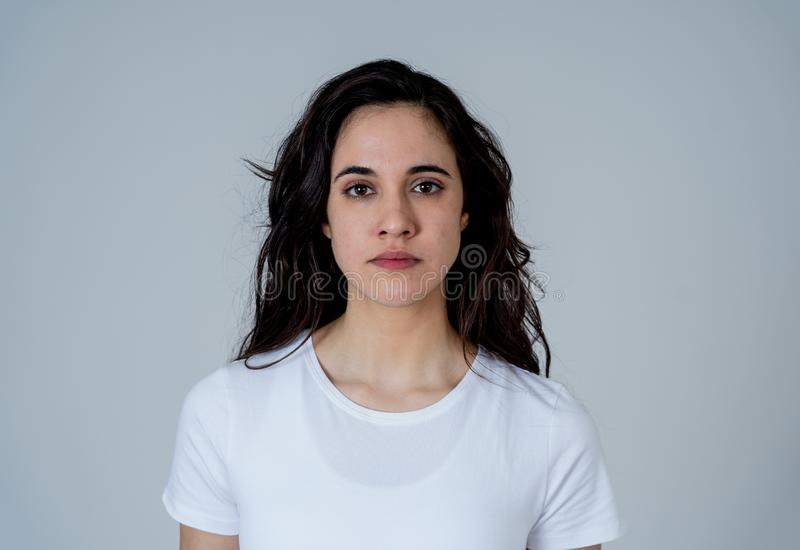 Portrait of beautiful young latin woman with angry and furious face. Human expressions and emotions. Close up of young attractive frustrated latin woman in stock images