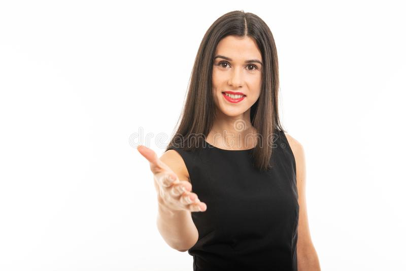 Portrait of beautiful young lawyer posing offering hand shake stock photography