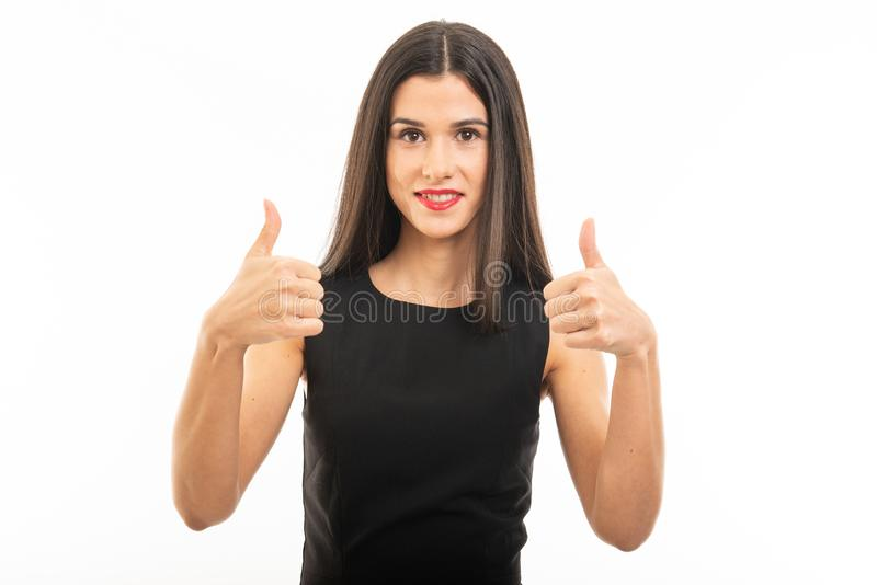 Portrait of beautiful young lawyer posing showing double  like gesture stock photo