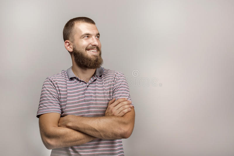 Portrait of a beautiful young man with a beard in his daily shirt. royalty free stock photography