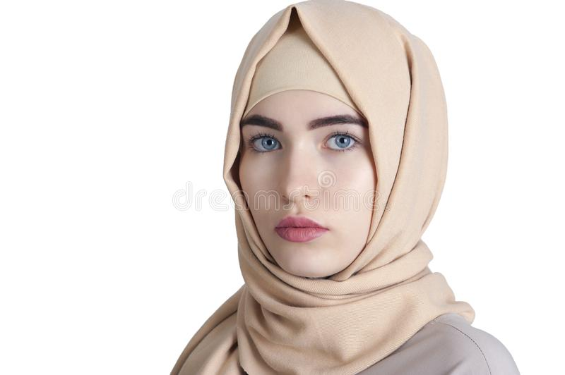 Portrait of a beautiful young muslim woman in hijab on isolated white background royalty free stock image
