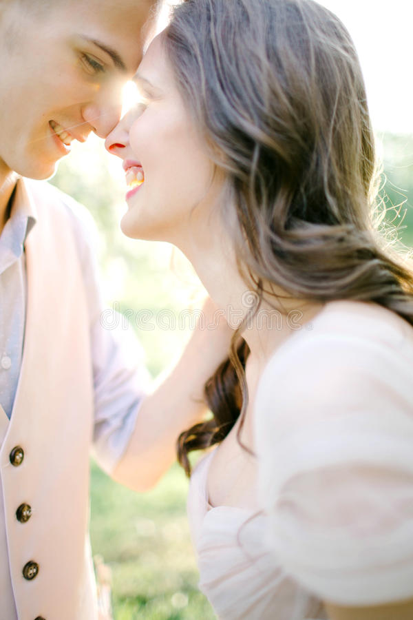 Portrait of beautiful young newlyweds outdoors over sunlight royalty free stock photography