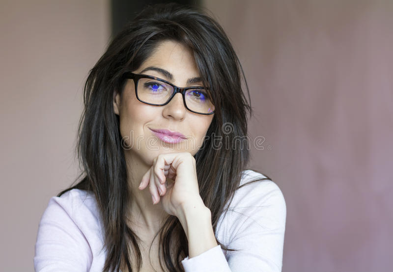 Portrait of beautiful young smiling woman with modern eyeglasses royalty free stock photography