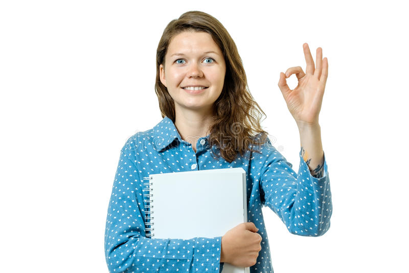 Portrait of a beautiful young student girl showing ok sign stock photo
