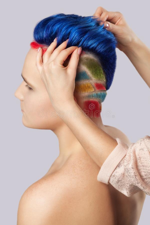 Portrait of a beautiful young teenager with a beautiful creative hairstyle, hair painted royalty free stock photography