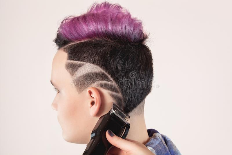 Portrait of a beautiful young teenager with a beautiful creative hairstyle, hair painted in pink stock photo