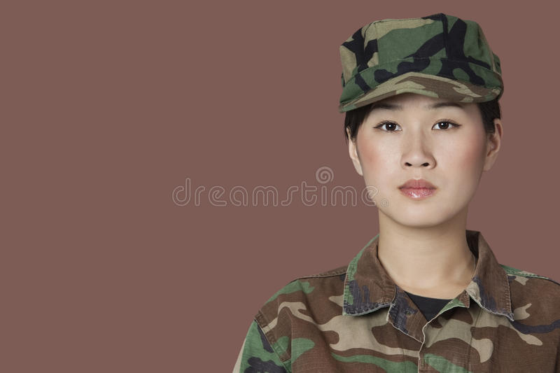 Portrait of beautiful young US Marine Corps soldier over brown background stock photo