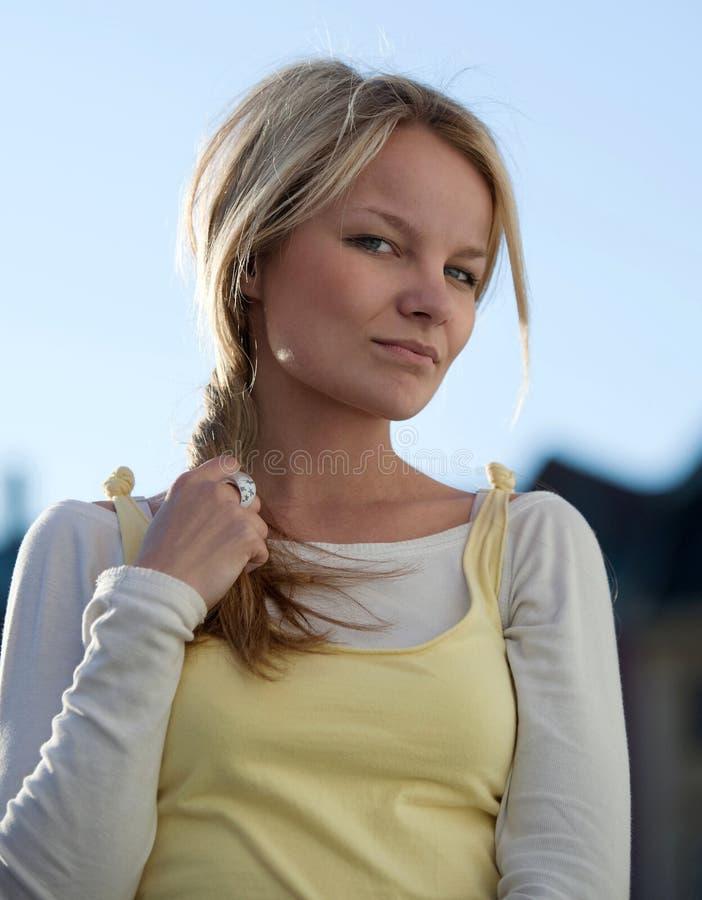 Portrait of a beautiful young woman. Closeup portrait of a beautiful young woman outdoor royalty free stock image