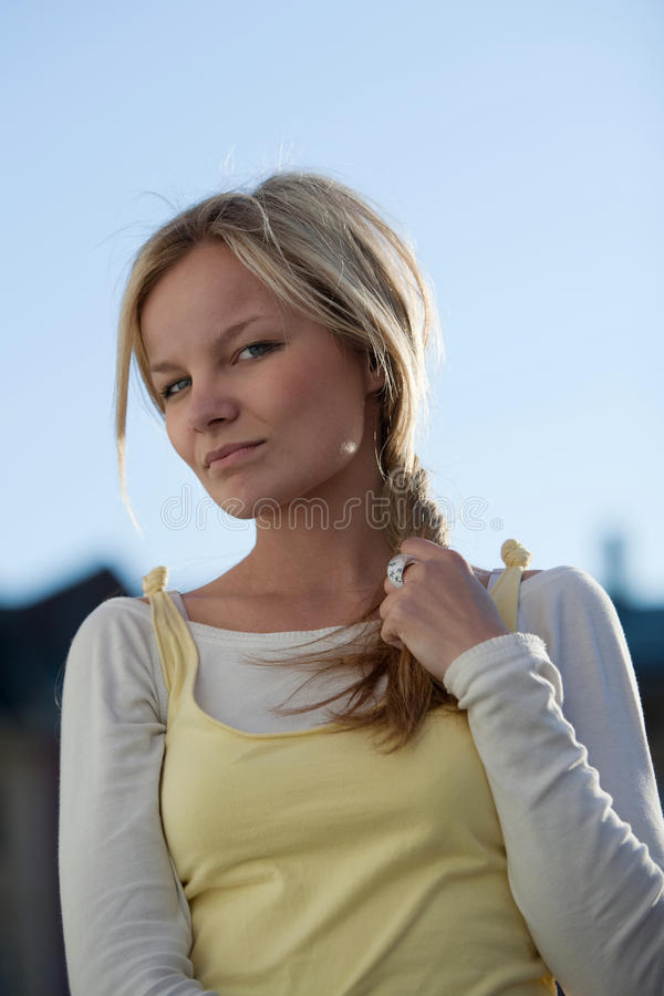 Portrait of a beautiful young woman. Closeup portrait of a beautiful young woman outdoor royalty free stock photography