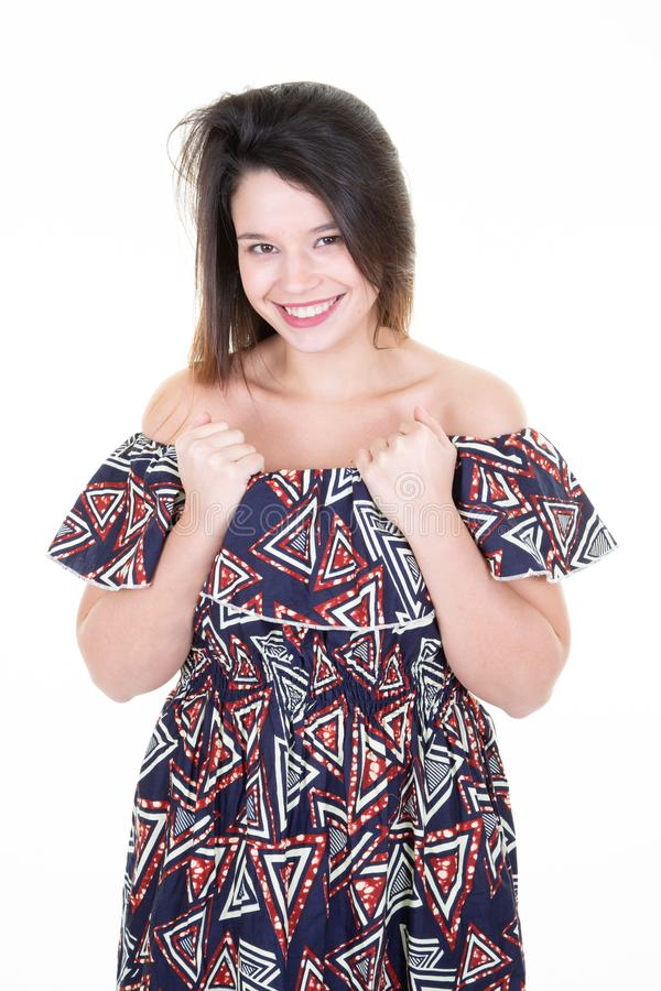Portrait of beautiful young woman in african clothes caucasian on her twenties brunette with long hair Looking at camera and stock photography