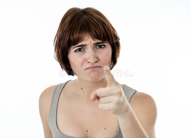 Portrait of a beautiful young woman with angry face looking furious. Human expressions and emotions. Close up of young attractive frustrated caucasian woman with royalty free stock images