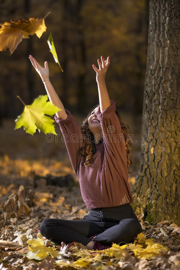 A portrait of a beautiful young woman in an autumn forest. Lifestyle, autumn fashion, beauty. stock image