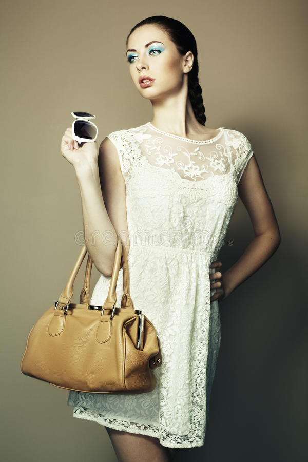 Download Portrait Of Beautiful Young Woman With Bag Stock Photo - Image: 26544762
